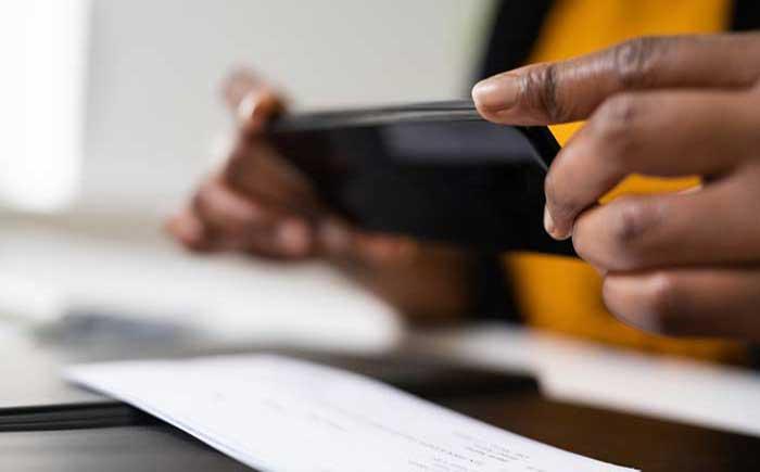 person depositing a check via phone