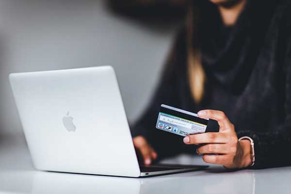 executive using a credit card for an online purchase