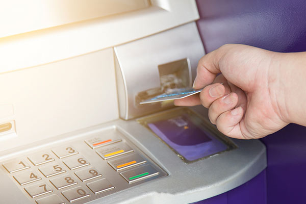 person using an atm to get cash