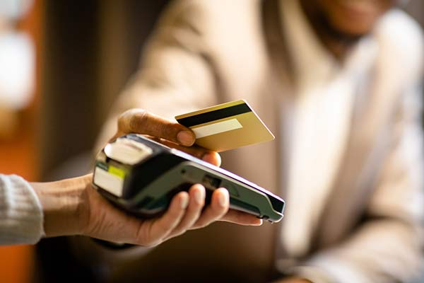 businessman using a credit card to pay for a client dinner