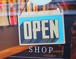 shop door with sign that says Open