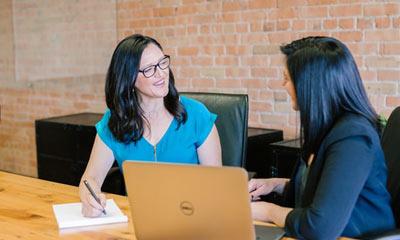 two women discussing a bank loan