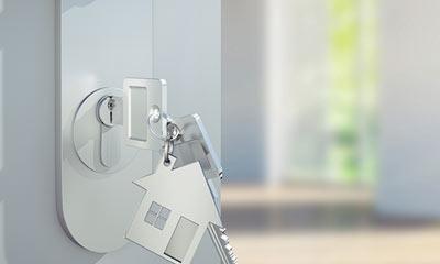 key in the door of a new home