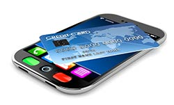 debit card on top of mobile phone