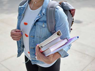 college student holding textbooks